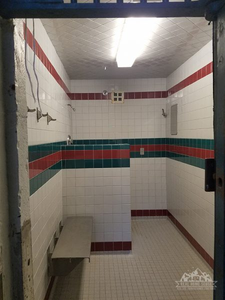 Shower located at the entrance to the cellblock.